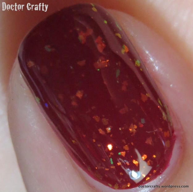 Closeup of Zoya Chloe over OPI Malaga Wine