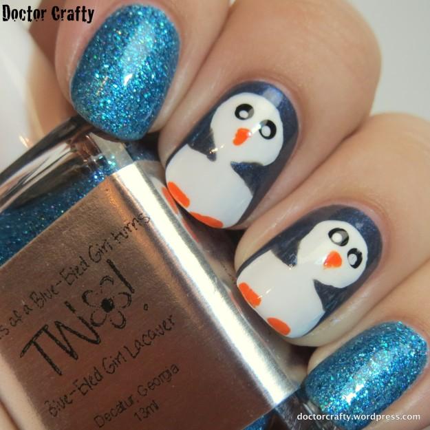 Sparkly penguin manicure